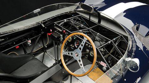 Motor vehicle, Mode of transport, Steering part, Steering wheel, Automotive design, Vehicle door, Classic car, Luxury vehicle, Car seat, Center console,