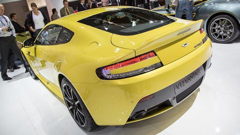 Tire, Wheel, Automotive design, Vehicle, Yellow, Land vehicle, Vehicle registration plate, Car, Performance car, Fender,