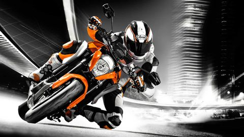 Motorcycle, Motorcycle racing, Orange, Personal protective equipment, Motorcycling, Sports gear, Motorsport, Motorcycle racer, Motorcycle helmet, Motorcycle accessories,