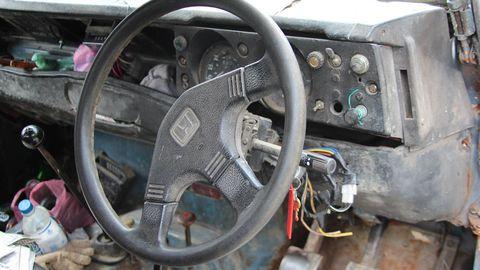 Motor vehicle, Steering part, Mode of transport, Steering wheel, Transport, Gauge, Auto part, Speedometer, Automobile pedal, Odometer,