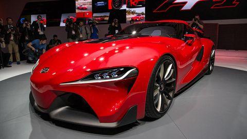Wheel, Automotive design, Event, Vehicle, Red, Car, Auto show, Exhibition, Performance car, Fender,