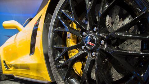 Automotive design, Alloy wheel, Yellow, Spoke, Automotive wheel system, Transport, Rim, Auto part, Automotive exterior, Supercar,