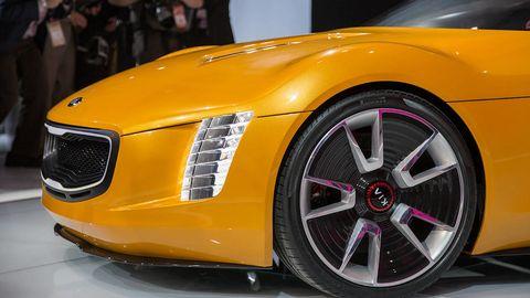 Motor vehicle, Tire, Automotive design, Vehicle, Yellow, Grille, Rim, Car, Alloy wheel, Hood,