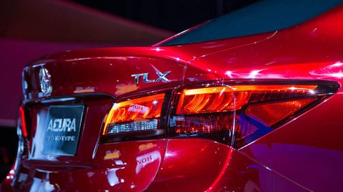 Automotive tail & brake light, Automotive design, Automotive lighting, Event, Red, Car, Automotive exterior, Personal luxury car, Full-size car, Light,