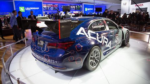 Automotive design, Vehicle, Event, Land vehicle, Car, Auto show, Exhibition, Logo, Alloy wheel, Machine,