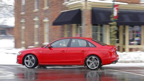 Tire, Wheel, Automotive design, Vehicle, Alloy wheel, Rim, Automotive parking light, Red, Full-size car, Car,
