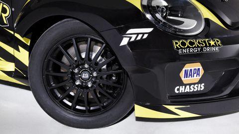 Motor vehicle, Tire, Automotive design, Automotive tire, Alloy wheel, Automotive wheel system, Yellow, Automotive exterior, Rim, Automotive lighting,