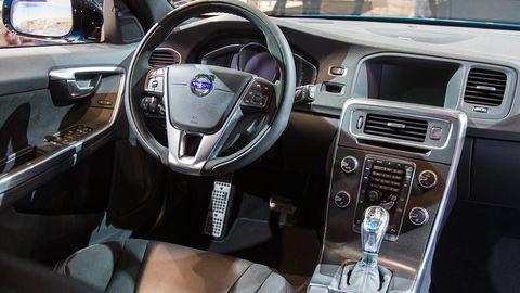 Motor vehicle, Steering part, Automotive design, Steering wheel, White, Technology, Automotive mirror, Vehicle audio, Center console, Radio,