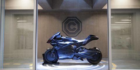 Motorcycle, Automotive design, Automotive exterior, Fender, Auto part, Motorcycle accessories, Fixture, Carbon, Cobalt blue, Motorcycle fairing,