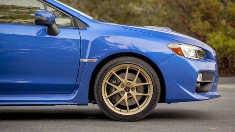 Tire, Wheel, Blue, Automotive design, Daytime, Vehicle, Automotive tire, Rim, Alloy wheel, Automotive lighting,