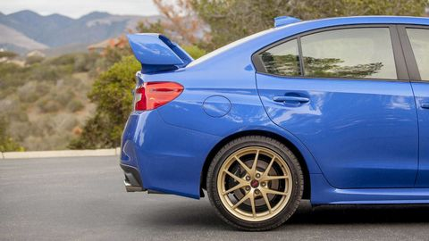 Tire, Wheel, Blue, Automotive design, Vehicle, Alloy wheel, Rim, Car, Automotive wheel system, Trunk,