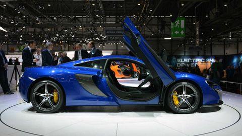 Tire, Wheel, Automotive design, Vehicle, Event, Land vehicle, Car, Auto show, Exhibition, Rim,