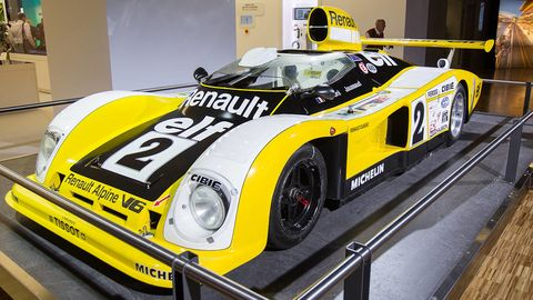 Automotive design, Yellow, Vehicle, Car, Fender, Sports car, Performance car, Logo, Race car, Headlamp,
