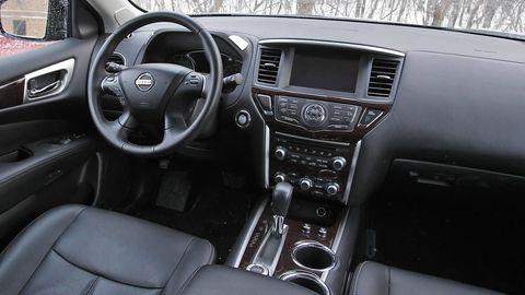 Motor vehicle, Steering part, Automotive design, Steering wheel, Brown, Automotive mirror, Transport, Photograph, Center console, Vehicle audio,