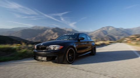 Tire, Wheel, Automotive design, Automotive mirror, Vehicle, Automotive tire, Automotive lighting, Road, Hood, Mountainous landforms,