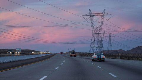 Motor vehicle, Road, Mode of transport, Sky, Overhead power line, Transport, Road surface, Asphalt, Highway, Infrastructure,