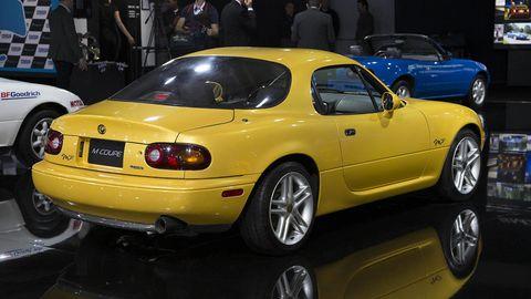 Tire, Wheel, Vehicle, Land vehicle, Automotive design, Yellow, Rim, Car, Automotive tire, Vehicle registration plate,