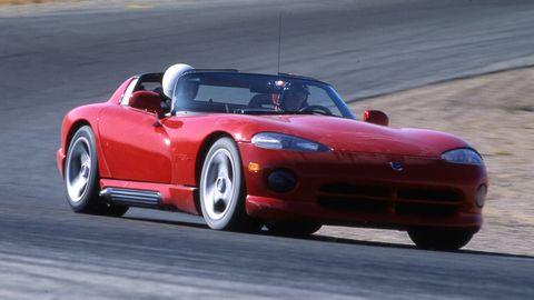 Tire, Wheel, Automotive design, Vehicle, Land vehicle, Hood, Car, Red, Performance car, Fender,