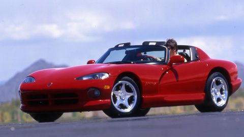 Tire, Wheel, Automotive design, Mode of transport, Vehicle, Land vehicle, Hood, Automotive mirror, Red, Car,