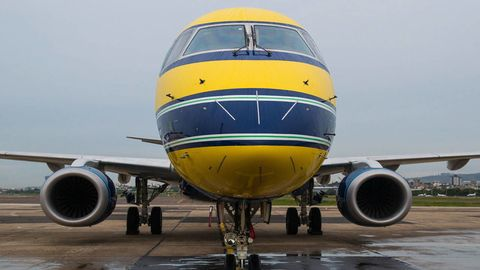 Airplane, Mode of transport, Aircraft, Airport, Yellow, Transport, Automotive tire, Air travel, Aviation, Airliner,