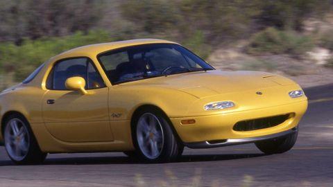 Tire, Automotive design, Vehicle, Yellow, Hood, Automotive parking light, Automotive mirror, Car, Rim, Automotive tire,