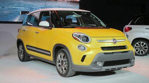 Tire, Motor vehicle, Automotive design, Vehicle, Land vehicle, Yellow, Car, Vehicle door, Automotive lighting, Rim,