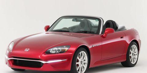Tire, Automotive design, Automotive mirror, Mode of transport, Vehicle, Land vehicle, Hood, Car, Red, Performance car,