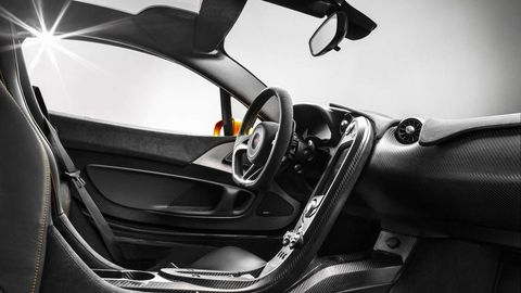 Motor vehicle, Automotive design, Steering part, Steering wheel, Luxury vehicle, Carbon, Supercar, Vehicle door, Sports car, Automotive mirror,