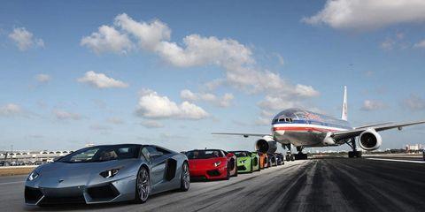 Airplane, Wheel, Mode of transport, Automotive design, Sky, Vehicle, Aircraft, Transport, Rim, Airliner,