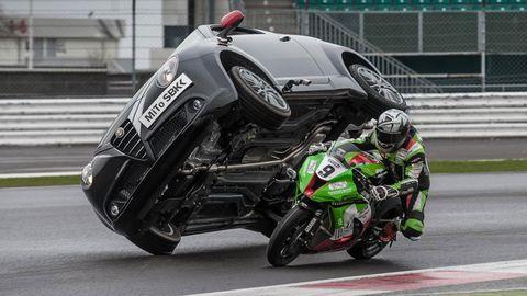 Motorcycle, Mode of transport, Automotive design, Motorcycle racing, Motorcycling, Automotive exterior, Fuel tank, Automotive lighting, Motorcycle helmet, Personal protective equipment,