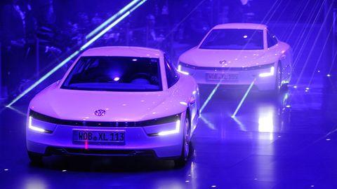 Mode of transport, Automotive design, Vehicle, Land vehicle, Event, Transport, Car, Vehicle registration plate, Personal luxury car, Auto show,