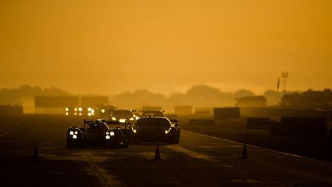 Automotive design, Automotive lighting, Road, Atmosphere, Atmospheric phenomenon, Amber, Horizon, Dusk, Automotive mirror, Evening,