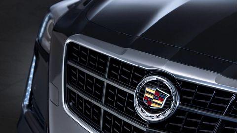 Automotive design, Grille, Car, Automotive exterior, Automotive lighting, Light, Logo, Black, Emblem, Headlamp,