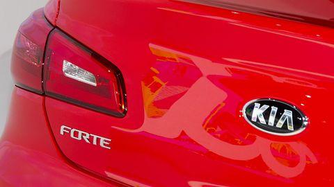 Motor vehicle, Automotive tail & brake light, Automotive design, Automotive lighting, Automotive exterior, Red, Light, Logo, Performance car, Automotive light bulb,