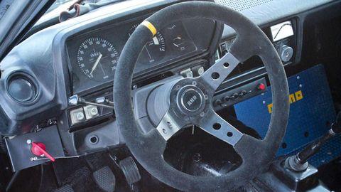 Motor vehicle, Mode of transport, Steering part, Steering wheel, Transport, Speedometer, Gauge, Tachometer, Odometer, Grey,