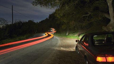 Mode of transport, Road, Automotive tail & brake light, Road surface, Automotive parking light, Automotive lighting, Asphalt, Full-size car, Mid-size car, Personal luxury car,