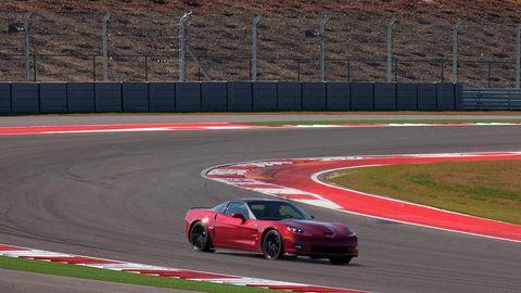 Tire, Automotive design, Vehicle, Land vehicle, Car, Race track, Sport venue, Alloy wheel, Performance car, Rim,