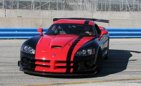 Automotive design, Hood, Car, Headlamp, Performance car, Automotive lighting, Sports car racing, Sports car, Bumper, Motorsport,