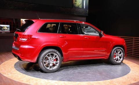Tire, Wheel, Automotive design, Vehicle, Automotive tire, Alloy wheel, Automotive tail & brake light, Car, Rim, Red,