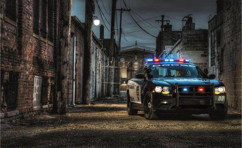 Automotive lighting, Police car, Emergency service, Headlamp, Automotive parking light, Police, Night, Emergency vehicle, Law enforcement, Metropolitan area,