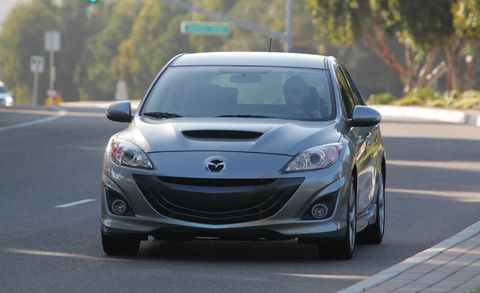 Land vehicle, Vehicle, Car, Mazda, Mazdaspeed3, Automotive design, Hatchback, Rim, Hood, Automotive fog light,