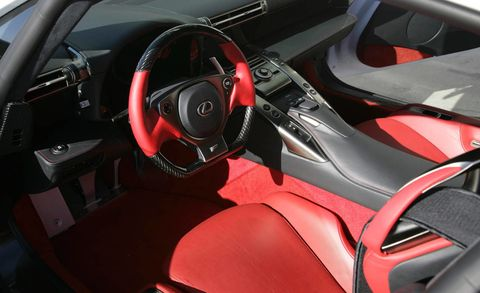 Motor vehicle, Mode of transport, Steering part, Automotive design, Steering wheel, Red, Car seat, Personal luxury car, Carmine, Center console,