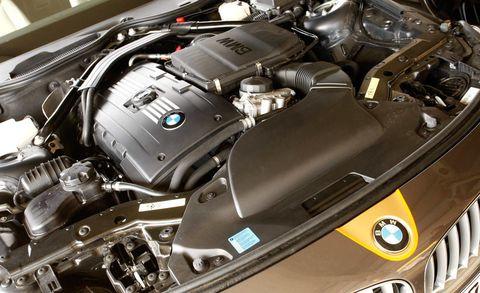 Automotive design, Engine, Personal luxury car, Luxury vehicle, Automotive engine part, Automotive air manifold, Automotive fuel system, Machine, Carbon, Automotive super charger part,
