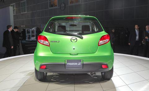 Motor vehicle, Automotive design, Vehicle, Automotive exterior, Car, Suit, Coat, Fender, Automotive lighting, Glass,