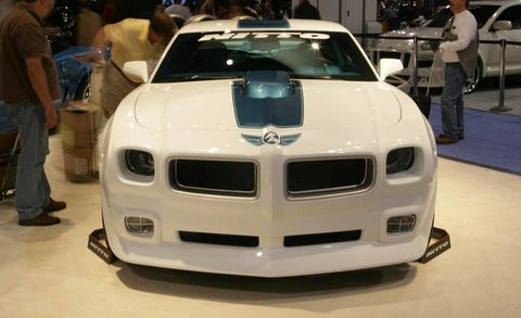 Automotive design, Vehicle, Automotive exterior, Hood, Grille, Bumper, Personal luxury car, Luxury vehicle, Exhibition, Sports car,