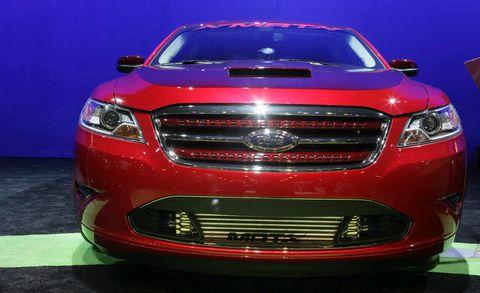 Motor vehicle, Automotive design, Blue, Daytime, Vehicle, Automotive lighting, Grille, Headlamp, Hood, Car,