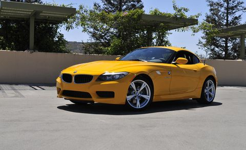 Automotive design, Yellow, Hood, Car, Rim, Grille, Fender, Performance car, Luxury vehicle, Personal luxury car,