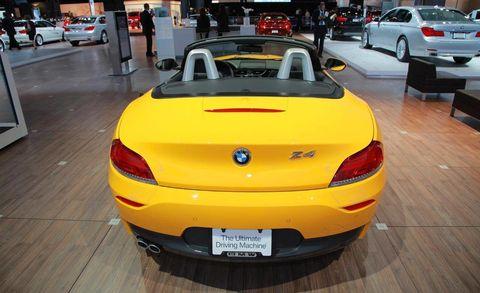 Motor vehicle, Automotive design, Vehicle, Yellow, Land vehicle, Vehicle registration plate, Car, Automotive lighting, Automotive exterior, Personal luxury car,