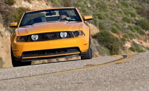 Automotive design, Yellow, Vehicle, Hood, Headlamp, Automotive lighting, Road, Landscape, Car, Grille,