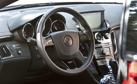Motor vehicle, Steering part, Automotive design, Brown, Steering wheel, Transport, White, Speedometer, Technology, Center console,